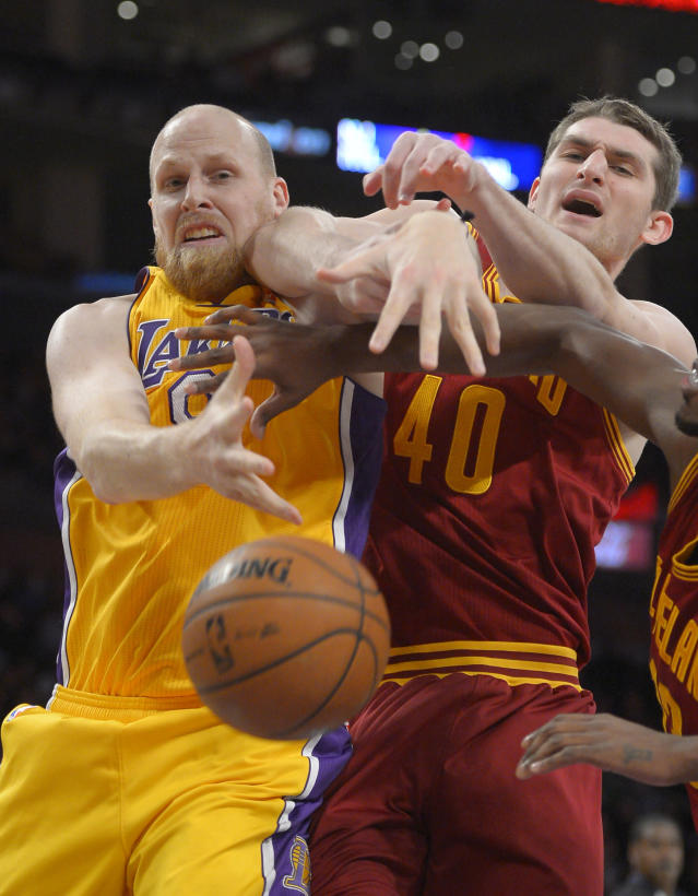 Los Angeles Lakers center Chris Kaman, left, and Cleveland Cavaliers center Tyler Zeller vie for a rebound during the first half of an NBA basketball game, Tuesday, Jan. 14, 2014, in Los Angeles. (AP Photo/Mark J. Terrill)