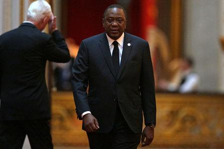 Kenya's President Uhuru Kenyatta arrives to attend The Queen's Dinner during The Commonwealth Heads of Government Meeting (CHOGM), at Buckingham Palace in London