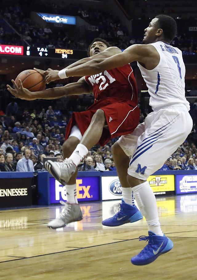 Nicholls guard Shane Rillieux (21) goes to the basket against Memphis guard Chris Crawford (3) in the first half of an NCAA college basketball game on Saturday, Nov. 23, 2013, in Memphis, Tenn. (AP Photo/Lance Murphey)