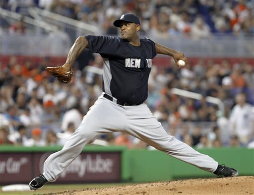 New York Yankees' CC Sabathia pitches against the Miami Marlins in the third inning of a spring training baseball game in Miami, Sunday, April 1, 2012. (AP Photo/Alan Diaz)