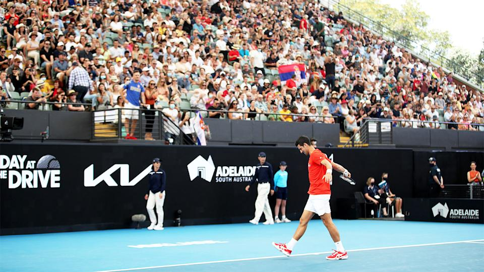 Novak Djokovic (pictured) warming up in front of a full crowd ahead of an exhibition match in Adelaide.