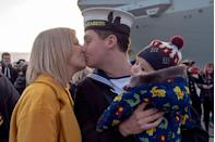 <p>Lance Jones kisses his fiancee after meeting his 14-week-old baby for the first time. He was a crewman on the HMS Queen Elizabeth, which had been deployed for four months.</p>