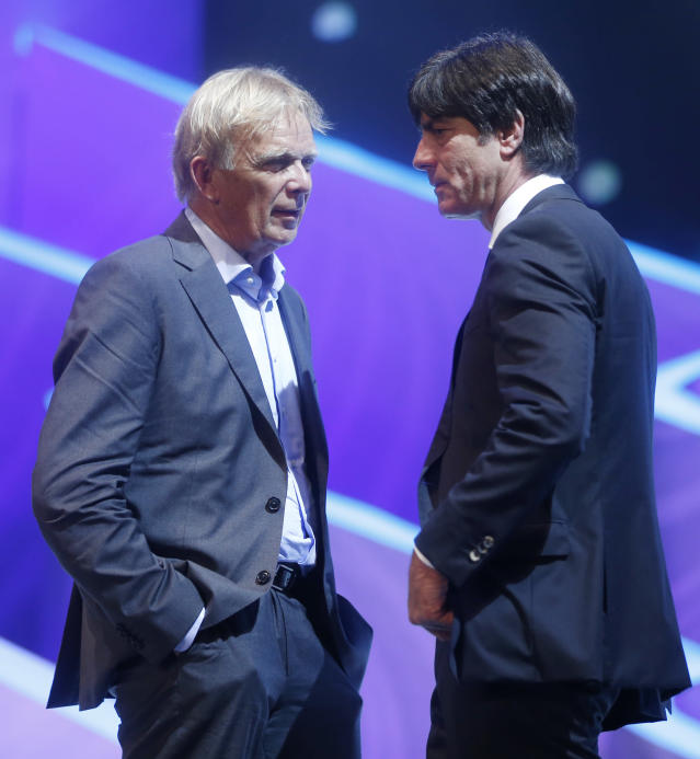 Germany head coach Joachim Loew, right, and Cameroon head coach Volker Finke from Germany talk during the draw ceremony for the 2014 soccer World Cup in Costa do Sauipe near Salvador, Brazil, Friday, Dec. 6, 2013. (AP Photo/Andre Penner)