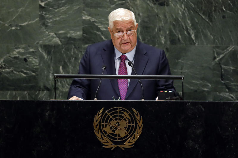 Syria's Deputy Prime Minister Walid Al-Moualem addresses the 74th session of the United Nations General Assembly, Saturday, Sept. 28, 2019. (AP Photo/Richard Drew)