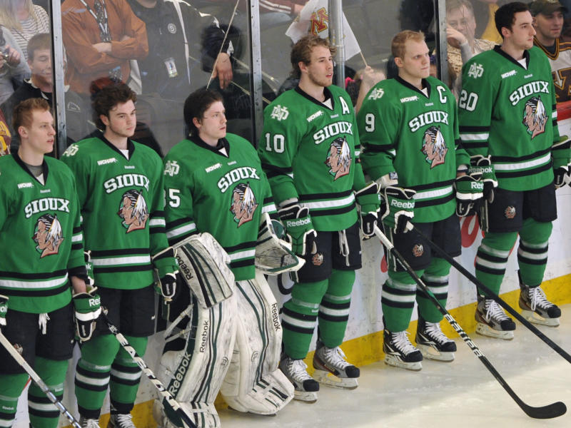 FILE - This March 16, 2012, file photo shows North Dakota hockey players wearing Fighting Sioux logo jerseys that were replaced by new jerseys during WCHA Final Five Championships in St. Paul, Minn. The years-long battle over the University of North Dakota's Fighting Sioux moniker is in voters' hands Tuesday, June 12, 2012, as a measure to nix the nickname hits the ballot. (AP Photo/Jim Mone, File)