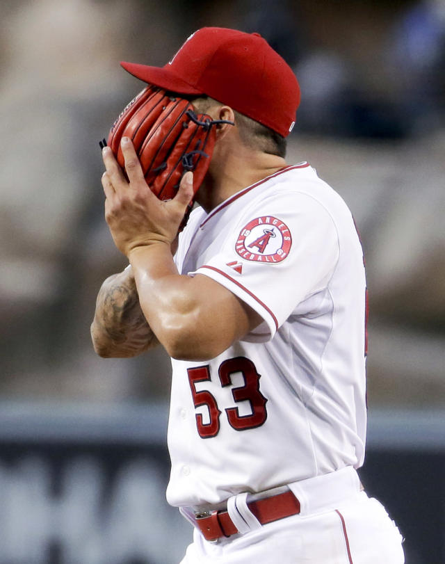 Los Angeles Angels starting pitcher Hector Santiago walks off the field after giving up 5 runs to the New York Yankees during the first inning of a baseball game in Anaheim, Calif., Wednesday, May 7, 2014. (AP Photo/Chris Carlson)