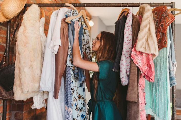 """<p>Holding on to items you don't need or use is one of the biggest ways your home becomes an unorganized mess, and this is especially true with clothes. To keep an eye on what you wear and don't wear, try the hanger trick. </p><p>""""Simply turn your hangers around in your closet. As you wear items, return them to the closet with the hanger facing the normal way,"""" says Amanda Clark, owner of <a href=""""https://www.eversoorganized.com/"""" rel=""""nofollow noopener"""" target=""""_blank"""" data-ylk=""""slk:Ever So Organized®️"""" class=""""link rapid-noclick-resp"""">Ever So Organized®️</a>. """"This is a visual way to see what items you actually wear. In reality, most people wear 20% of their clothes 80% of the time."""" </p>"""