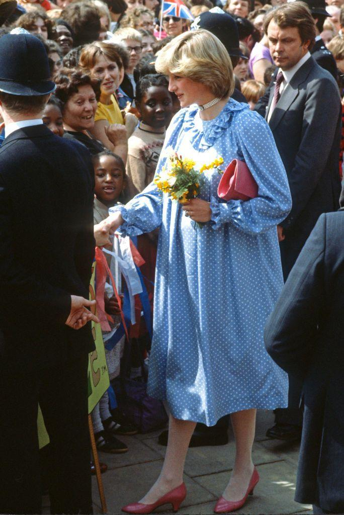 <p>The Princess opted to pair a ruffled polka dot dress with a chocker and red accessories during an outing in London in May 1982.<br></p>