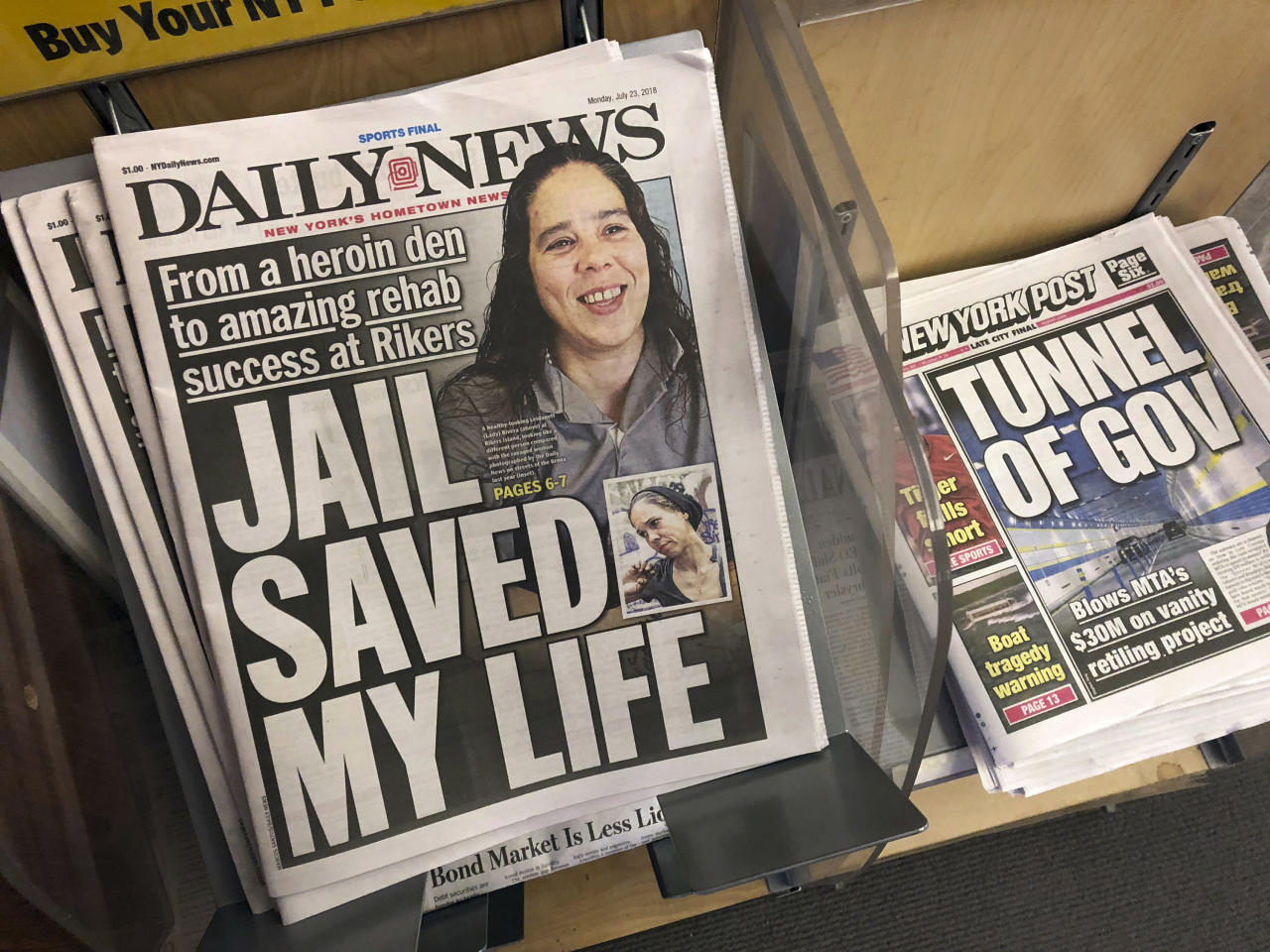 Copies of the New York Daily News are for sale at a news stand in New York, Monday, July 23, 2018, after the paper told employees that the newspaper is reducing its editorial staff by 50 percent. (AP Photo/Mark Lennihan)
