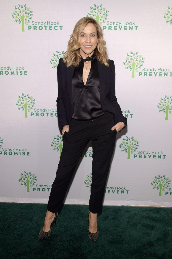 <p>The singer gets silky with a peekaboo top underneath her suit set. (Photo: Getty Images) </p>