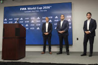 Colin Smith, FIFA Chief Tournaments & Events Officer, left, Victor Montagliani, FIFA vice-president and CONCACAF president, center, and Dan Corso, president of Atlanta Sports Council, listen to a question during a press conference, Friday afternoon, Sept. 17, 2021 at Mercedes-Benz Stadium in Atlanta. Officials were touring the stadium as part of the FIFA World Cup 2026 Candidate Host City Tour. (AP Photo/Ben Gray)
