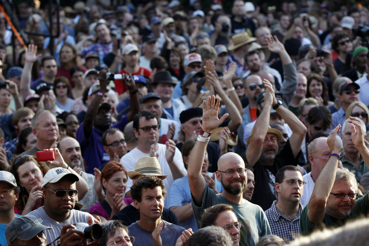 People in the crowd cheer at a sunrise concert marking International Jazz Day in New Orleans, Monday, April 30, 2012. The performance, at Congo Square near the French Quarter, is one of two in the United States that day; the other is in the evening in New York. Thousands of people across the globe are expected to participate in International Jazz Day, including events in Belgium, France, Brazil, Algeria and Russia. (AP Photo/Gerald Herbert)