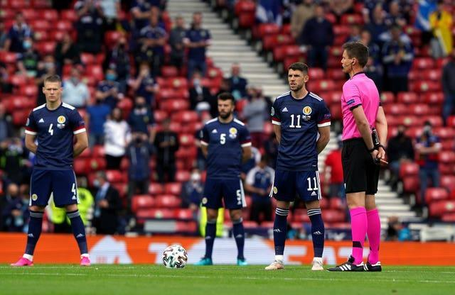 Scotland's players have been standing against racism before kick-off.