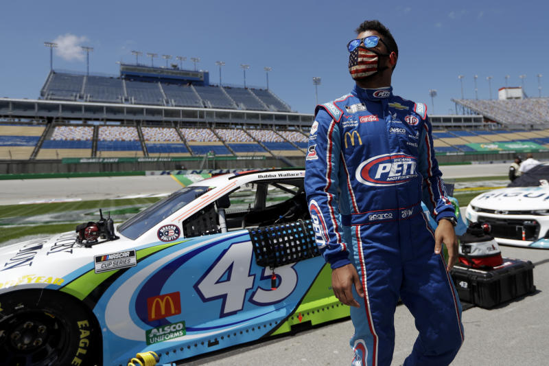 Bubba Wallace (43) waits for the start of a NASCAR Cup Series auto race Sunday, July 12, 2020, in Sparta, Ky. (AP Photo/Mark Humphrey)