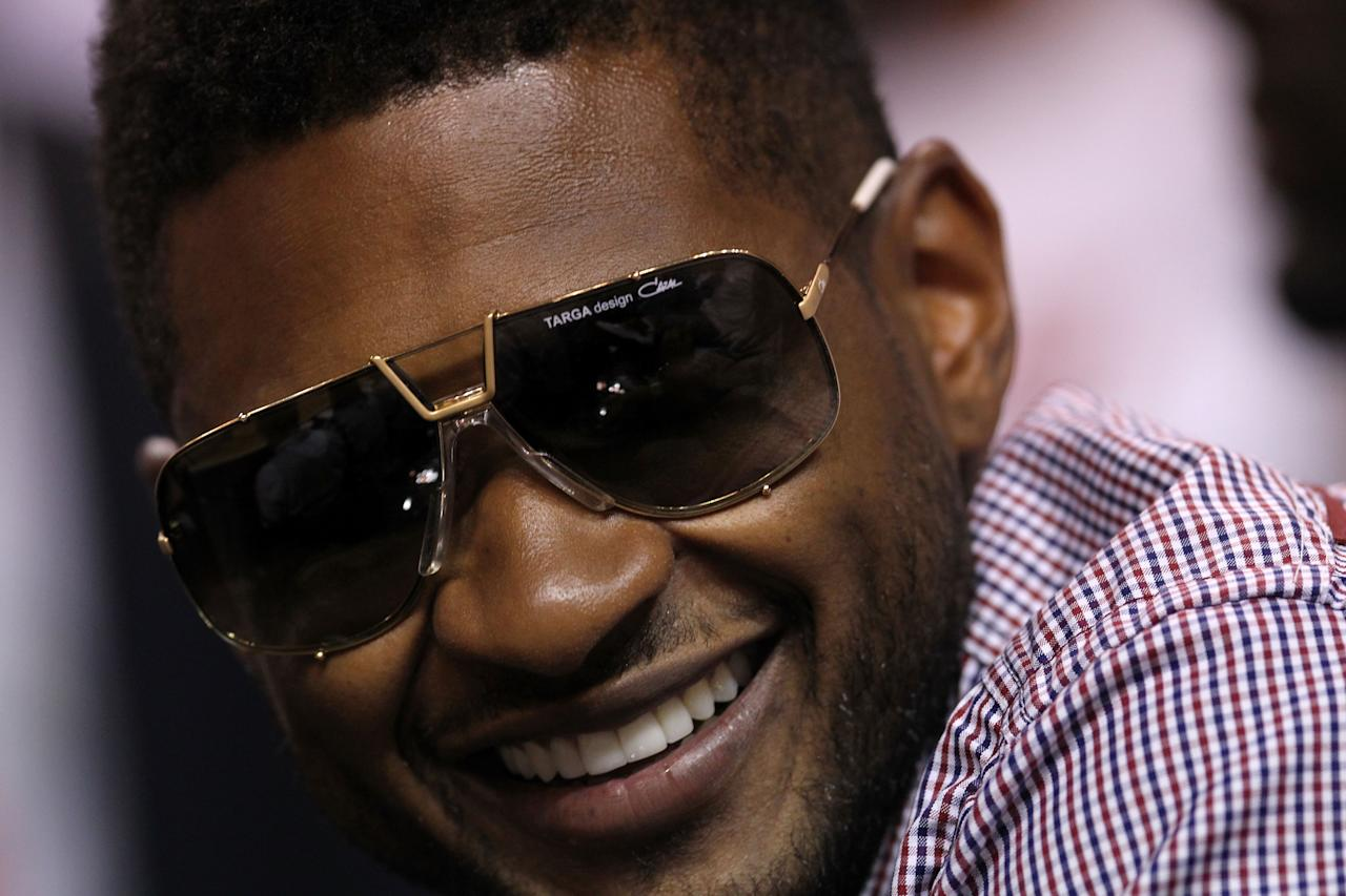 MIAMI, FL - JUNE 12:  Singer Usher attends Game Six of the 2011 NBA Finals between the Dallas Mavericks and the Miami Heat at American Airlines Arena on June 12, 2011 in Miami, Florida. NOTE TO USER: User expressly acknowledges and agrees that, by downloading and/or using this Photograph, user is consenting to the terms and conditions of the Getty Images License Agreement.  (Photo by Ronald Martinez/Getty Images)