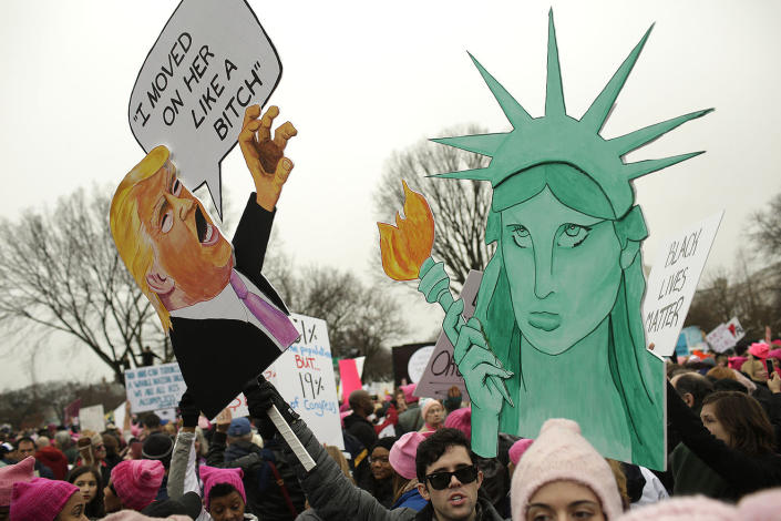 <p>Protesters display their signs in Washington, DC, during the Womens March on January 21, 2017. (JOSHUA LOTT/AFP/Getty Images) </p>