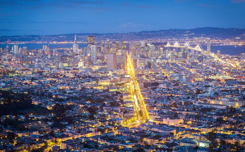 San Francisco at night, with Market Street lit up. Private cars are now banned on the thoroughfare. (Photo: uschools via Getty Images)