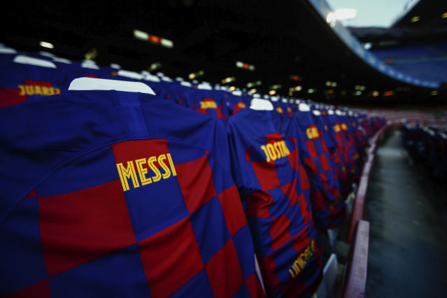 FC Barcelona soccer shirts are displayed at the Camp Nou stadium stands prior the Spanish La Liga soccer match between FC Barcelona and Atletico Madrid in Barcelona, Spain, Tuesday, June 30, 2020. (AP Photo/Joan Monfort)
