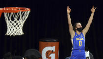 UCLA guard Chantel Horvat (0) celebrates a teammate's 3-point against Arizona during the second half of an NCAA college basketball game in the semifinals of the Pac-12 women's tournament Friday, March 5, 2021, in Las Vegas. (AP Photo/Isaac Brekken)