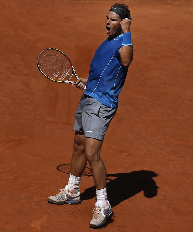 Rafael Nadal from Spain celebrates a point during a Madrid Open tennis tournament match against Tomas Berdych from Czech Republic in Madrid, Spain, Friday, May 9, 2014. (AP Photo/Andres Kudacki)