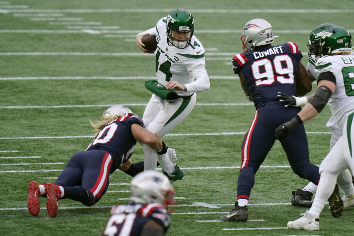 New England Patriots defensive lineman Chase Winovich, left, sacks New York Jets quarterback Sam Darnold in the first half of an NFL football game, Sunday, Jan. 3, 2021, in Foxborough, Mass. (AP Photo/Charles Krupa)