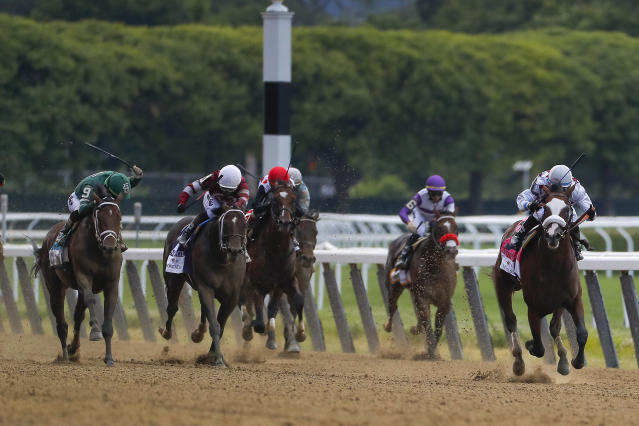 Tiz the Law (8), with jockey Manny Franco up, right, leads the pack down the home stretch during the152nd running of the Belmont Stakes horse race, Saturday, June 20, 2020, in Elmont, N.Y. Tiz the Law won the race. (AP Photo/Seth Wenig)