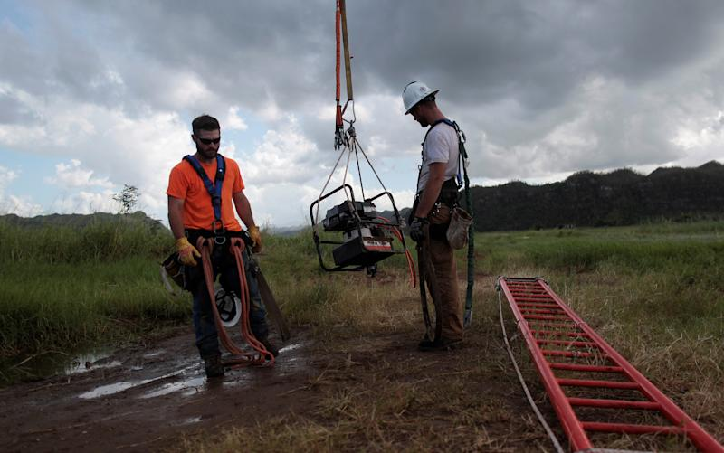 Here are some workers helping to fix Puerto Rico's power grid, at quite a hefty cost to the people of Puerto Rico.