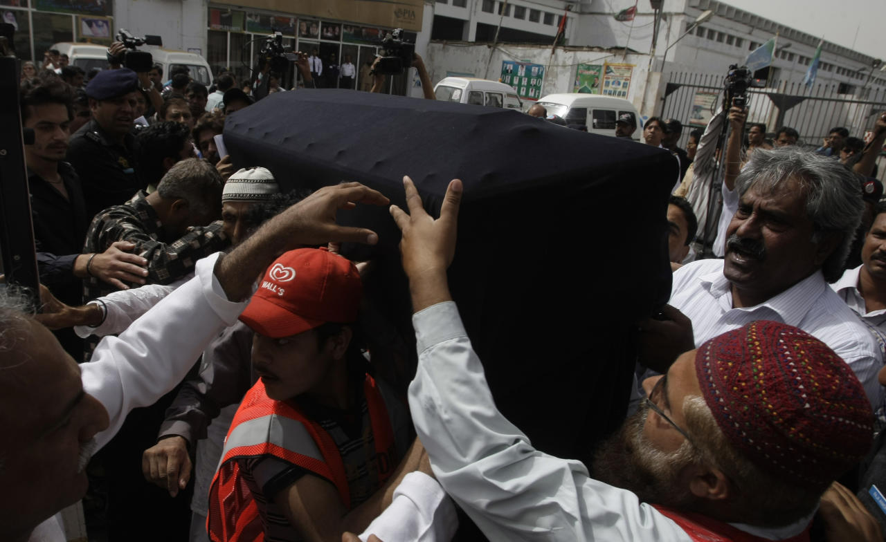 People carry a body of a Pakistani acid attack victim Fakhra Younnus, at Karachi airport in Pakistan on Sunday, March 25, 2012. Fakhra who committed suicide by jumping from the sixth floor of her flat in Rome, was a victim of an acid attack allegedly carried out 12 years ago by her husband, the son of a feudal politician. (AP Photo)