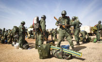 This picture provided by the French Army Communications Audiovisual office (ECPAD) and released Monday Jan. 28, 2013 shows Malians soldiers arriving at Gao airport, north of Mali, Saturday, Jan. 26, 2013. French and Malian forces pushed toward the fabled desert town of Timbuktu on Sunday, as the two-week-long French mission gathered momentum against the Islamist extremists who have ruled the north for more than nine months. (AP Photo/Ghislain Mariette, EMA-ECPAD)