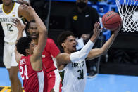 Baylor guard MaCio Teague (31) shoots ahead of Houston guard Quentin Grimes (24) during the second half of a men's Final Four NCAA college basketball tournament semifinal game, Saturday, April 3, 2021, at Lucas Oil Stadium in Indianapolis. (AP Photo/Darron Cummings)
