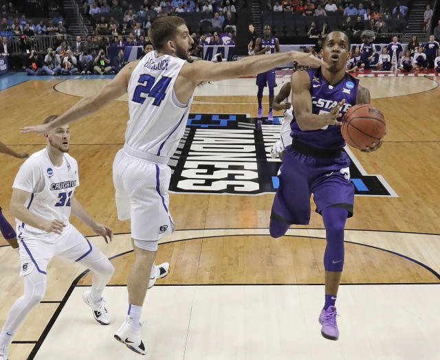Kansas State's Barry Brown, right, drives past Creighton's Mitch Ballock during the first half of a first-round game in the NCAA men's college basketball tournament in Charlotte, N.C., Friday, March 16, 2018. (AP Photo/Gerry Broome)
