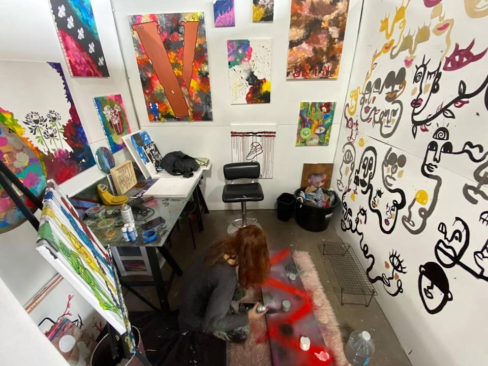 "Arelys Ripoll works on the floor in her studio at Charlotte Art League. CAL executive director Jim Dukes says Ripoll is an evolving young artist whose current work is ""subtle and raw."""