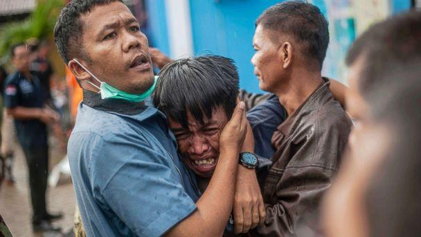 PHOTO: A man reacts after identifying his relative among the bodies of tsunami victims in Carita, Indonesia, Dec. 23, 2018. (Fauzy Chaniago/AP)