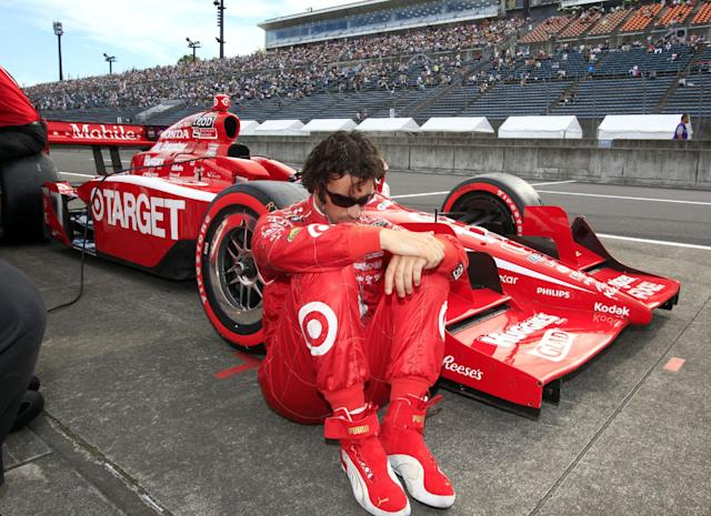 FILE - In this Sept. 17, 2011, file photo, IndyCar driver Dario Franchitti, of Scotland, sits by his car during the qualifying of the Indy Japan auto race at Twin Ring Motegi in Motegi, northeast of Tokyo, Japan. The three-time Indianapolis 500 winner said Thursday, Nov. 14, 2013, that doctors have told him he can no longer race because of injuries sustained in an IndyCar crash last month. He fractured his spine, broke his right ankle and suffered a concussion in the Oct. 6 crash at Houston. (AP Photo/Shizuo Kambayashi, File)