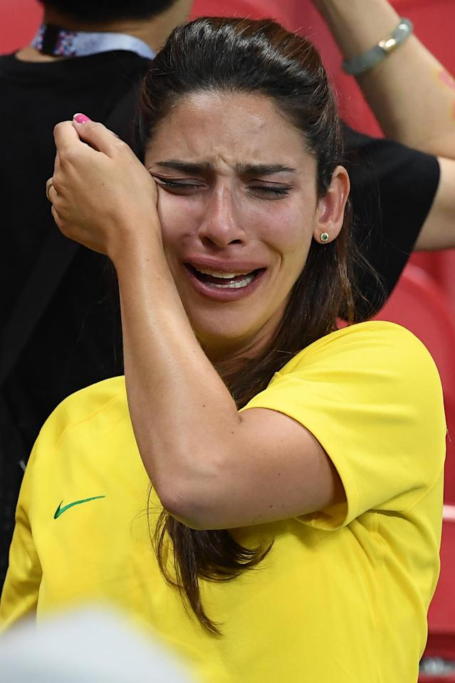 <p>A Brazil fan react to their loss during the Russia 2018 World Cup quarter-final football match between Brazil and Belgium at the Kazan Arena in Kazan on July 6, 2018. – Belgium beat World Cup favourites Brazil 2-1 on Friday to set up a semi-final against France in Saint Petersburg. (Photo by Jewel SAMAD / AFP) </p>
