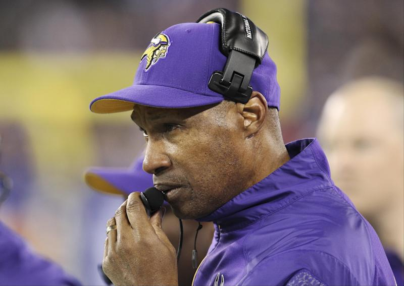 Minnesota Vikings head coach Leslie Frazier talks into his headset during the first half of an NFL football game against the New York Giants Monday, Oct. 21, 2013 in East Rutherford, N.J. (AP Photo/Peter Morgan)
