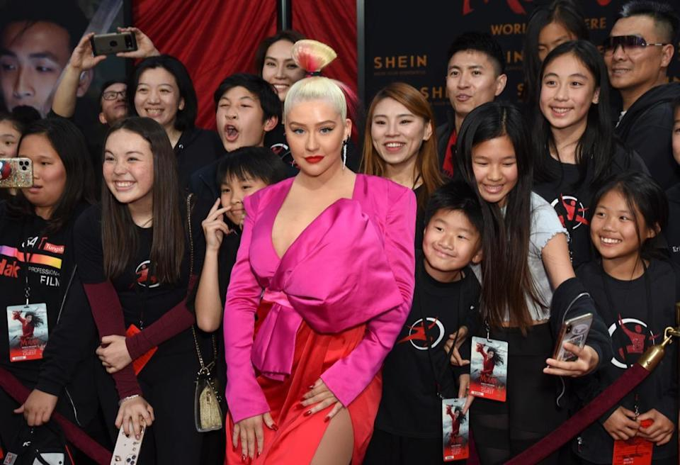 "HOLLYWOOD, CALIFORNIA - MARCH 09: Christina Aguilera attends Disney's ""Mulan"" World Premiere - Red Carpet - Fan Pen at Dolby Theatre on March 09, 2020 in Hollywood, California. (Photo by Presley Ann/Getty Images for SHEIN)"