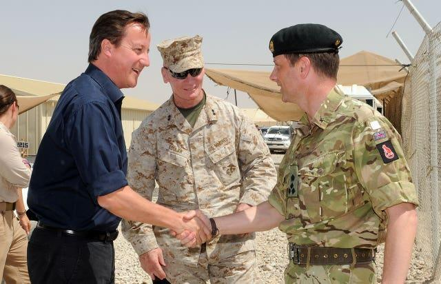 Picture from 2011 of Brigadier Nick Welch OBE, Deputy Commander Regional Command (Southwest) (RC SW), welcoming then prime minister David Cameron to Camp Leatherneck in Afghanistan's Helmand Province