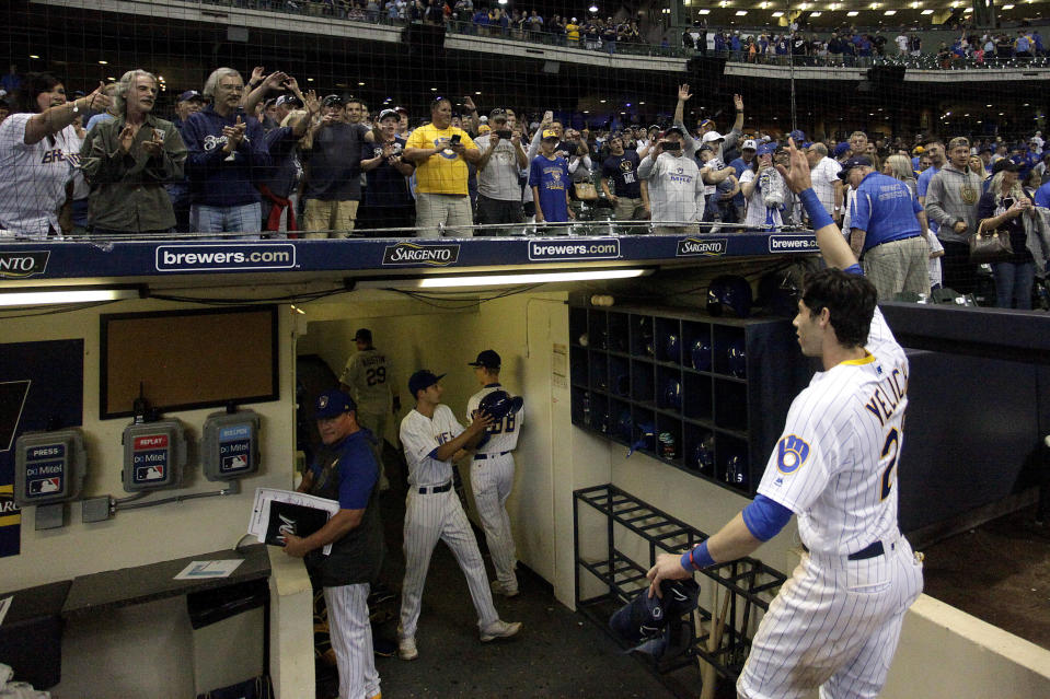 """FILE - In this Sept. 7, 2019, file photo, fans cheer as Milwaukee Brewers' Christian Yelich walks off the field after driving in the winning run with a double during the ninth inning of the team's baseball game against the Chicago Cubs in Milwaukee. Major League Baseball will start each extra inning this season by putting a runner on second base. This rule has been used since 2018 in the minor leagues, where it created more action and settled games sooner. I think its great, Yelich said. As a player, theres nothing worse than extra innings."""" (AP Photo/Aaron Gash, File)"""