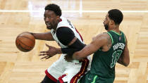 Miami Heat center Bam Adebayo, left, drives to the basket past Boston Celtics center Tristan Thompson during the second half of an NBA basketball game Tuesday, May 11, 2021, in Boston. (AP Photo/Charles Krupa)