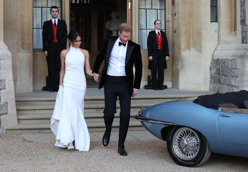 Newlyweds Meghan Markle and Prince Harry as they leave for their wedding reception at Frogmore House. [Photo: Getty]
