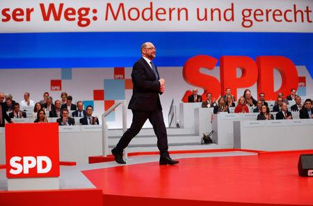 Social Democratic Party (SPD) leader Martin Schulz walks onto a podium during an SPD party convention in Berlin
