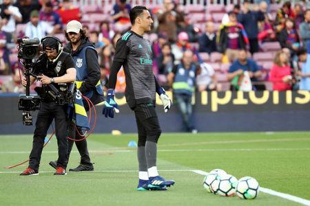 A cameraman uses a steadycam to film Real Madrid's goalkeeper Keylor Navas during warm-up before the Spanish Liga Santander soccer match between FC Barcelona and Real Madrid at Camp Nou stadium in Barcelona, Spain, May 6, 2018. Picture taken May 6, 2018. REUTERS/Sergio Perez