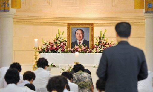 Unification Church members at a memorial service mourning the death of leader Sun Myung Moon in the church's Seoul headquarters on September 4. North Korean leader Kim Jong-Un has sent condolences Wednesday over Moon's death