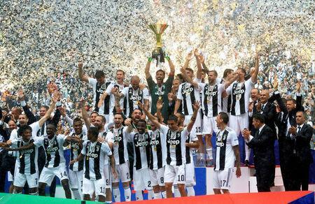 FILE PHOTO: Soccer Football - Serie A - Juventus vs Hellas Verona - Allianz Stadium, Turin, Italy - May 19, 2018 Juventus' Gianluigi Buffon lifts the trophy as the Juventus players celebrate winning the league. REUTERS/Massimo Pinca/File Photo