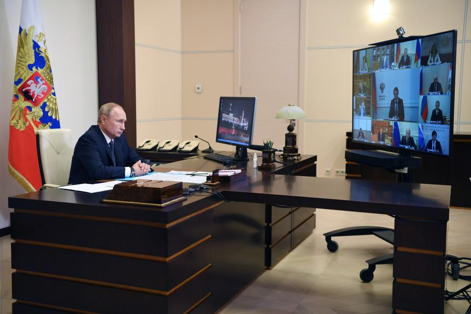 Russian President Vladimir Putin attends a cabinet meeting at the Novo-Ogaryovo residence outside Moscow, Russia, Tuesday, Aug. 11, 2020. Putin says that a coronavirus vaccine developed in the country has been registered for use and one of his daughters has already been inoculated. Speaking at a government meeting Tuesday, Putin said that the vaccine has proven efficient during tests, offering a lasting immunity from the coronavirus. (Alexei Nikolsky, Sputnik, Kremlin Pool Photo via AP)