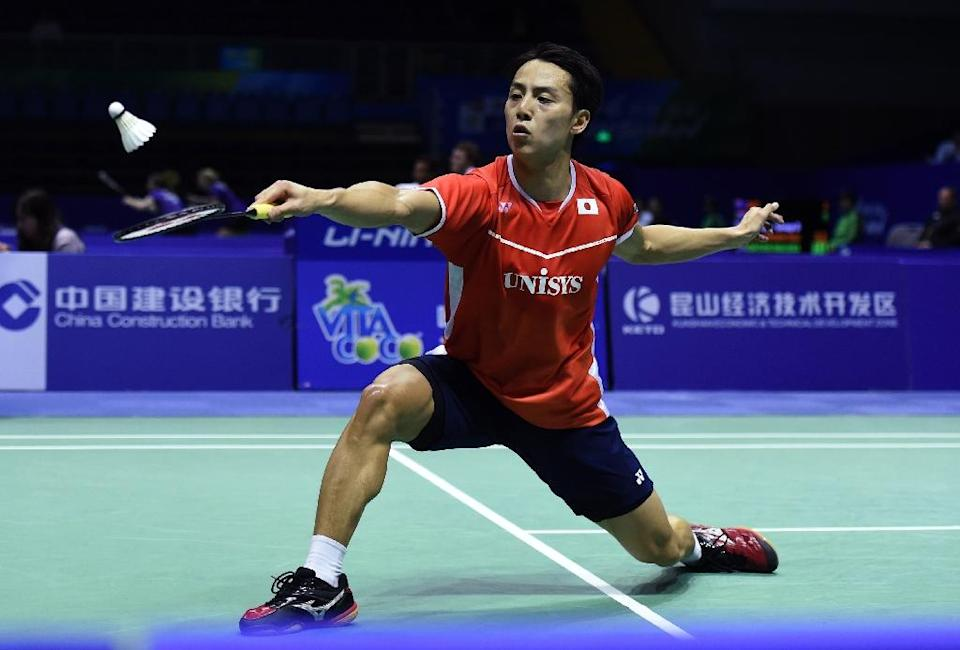 Takuma Ueda of Japan hits a return against Lin Dan of China during their men's singles group match in the Thomas Cup badminton tournament in Kunshan, eastern China's Jiangsu Province on May 18, 2016 (AFP Photo/Johannes Eisele)