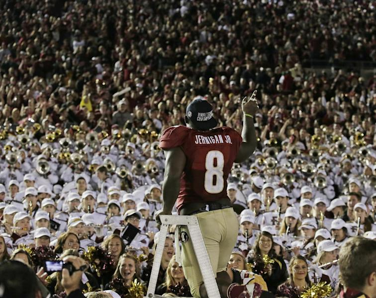 Florida State's Timmy Jernigan celebrates with fans after the NCAA BCS National Championship college football game against Auburn Monday, Jan. 6, 2014, in Pasadena, Calif. Florida State won 34-31. (AP Photo/Chris Carlson)