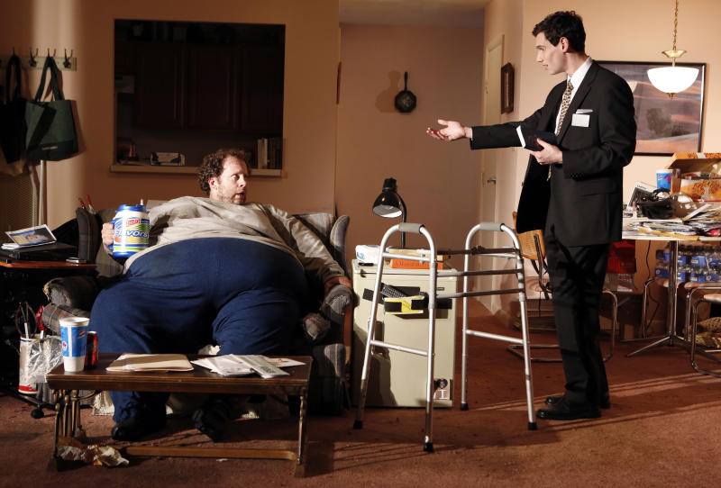 """This theater image released by The Publicity Office shows Shuler Hensley, left, and Cory Michael Smith in a scene from """"The Whale,"""" currently performing off-Broadway at Playwrights Horizons in New York.  (AP Photo/The Publicity Office, Joan Marcus)"""