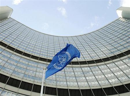 The flag of the International Atomic Energy Agency (IAEA) flies in front of the Vienna headquarters ..